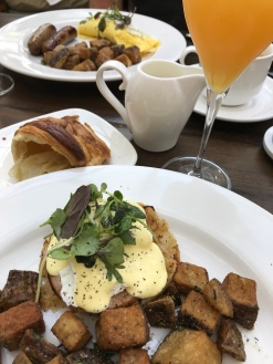 Great breakfast: Eggs benedict, omelet, croissant and mimosa