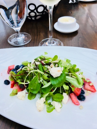 Local greens, goat cheese and strawberry salad