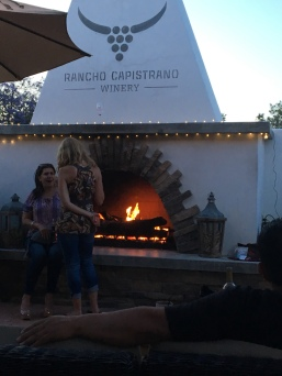 Outdoor dining by the fire at Rancho Capistrano Winery