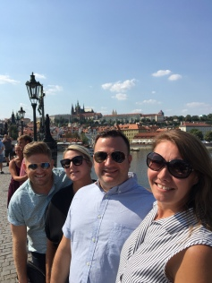Crossing the Charles Bridge...smiling in spite of the heat