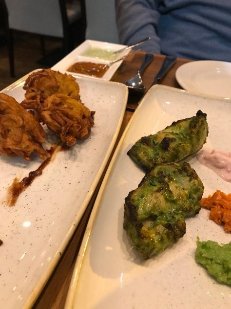 Onion fritters and chicken with green curry at Mango