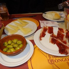 Typical Spanish snacks: Manchego cheese, olives and Iberico Jamon