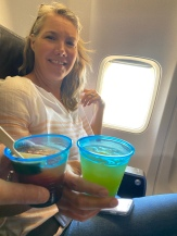 Securely in our seats with mandatory cocktails - we are heading back to the US